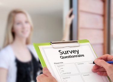 stock-photo-girl-answering-market-research-survey-questionnaire-questions-at-the-door-75977908-2